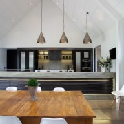 Country house with urban edge and contemporary kitchen architecture, ceiling, chair, countertop, daylighting, dining room, floor, flooring, furniture, house, interior design, kitchen, light fixture, living room, table, gray