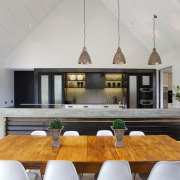 This kitchen has a sense of symmetry. However, ceiling, dining room, interior design, real estate, table, gray