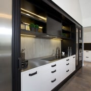 Country house with urban edge and contemporary kitchen cabinetry, countertop, interior design, kitchen, black, gray
