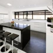Black and white contemporary kitchen with quartz benchtops cabinetry, countertop, cuisine classique, interior design, kitchen, product design, white