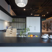 Modern black and white kitchen with grey-toned wood interior design, black