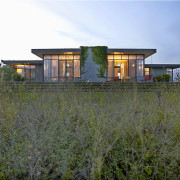 This vacation house, designed by architect Joan Chan architecture, cottage, facade, farmhouse, grass, home, house, land lot, landscape, property, real estate, rural area, sky