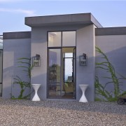 Symmetry defines the formal entry to this house architecture, building, facade, home, house, real estate, gray