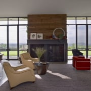Full-height glazing opens up this house to the architecture, furniture, house, interior design, living room, lobby, real estate, window, gray