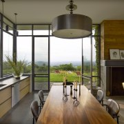 With the doors open, the kitchen in this architecture, dining room, home, house, interior design, real estate, window, brown