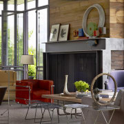 Steel I-beams form the fireplace surround in this chair, furniture, home, interior design, living room, lobby, table, window