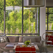 Sitting area in country house with glass walls home, house, interior design, living room, table, window