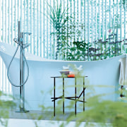 This contemporary, slipper-style freestanding bathtub, is matched with chair, furniture, home, interior design, product design, table, white, teal