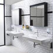 This white bathroom with wall of subway tiles floor, flooring, interior design, product design, tile, white