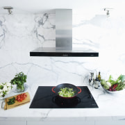 Smeg induction cooktop and wall-mount rangehood on a furniture, interior design, product design, table, white