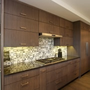 The cooking center of this kitchen is defined architecture, cabinetry, countertop, flooring, interior design, kitchen, room, under cabinet lighting, wood, brown, gray