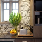 In addition to a coffee machine, the breakfast cabinetry, countertop, home, interior design, kitchen, under cabinet lighting, black
