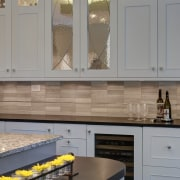 These kitchen cabinets are Maple with a Pearl cabinetry, countertop, cuisine classique, floor, flooring, home, interior design, kitchen, room, under cabinet lighting, window, gray