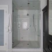Decorative tiles also feature in the steam shower bathroom, door, floor, interior design, plumbing fixture, room, gray