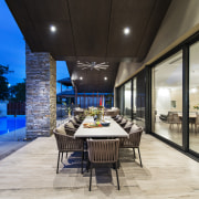 Alfresco dining area of expansive indoor-outdoor entertaining space estate, interior design, real estate, gray, black