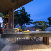 The barbecue is set in a granite-clad bench architecture, arecales, estate, home, house, landscape lighting, leisure, lighting, palm tree, property, real estate, resort, sky, swimming pool, vacation, villa, water, blue
