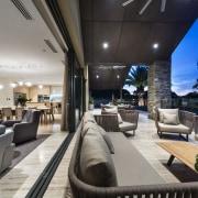 Floor-to-ceiling stacker doors slide back to either side, interior design, real estate, gray, black