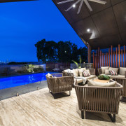 Outdoor sitting area with glass balustrade and pool estate, interior design, real estate, blue