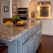 Smoky blue cabinetry makes the island a focal cabinetry, countertop, cuisine classique, floor, flooring, hardwood, home, interior design, kitchen, room, wood flooring, gray, brown