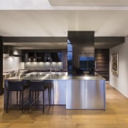 Sleek stainless steel cabinets and countertops give this countertop, floor, flooring, interior design, kitchen, table, gray
