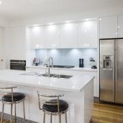 Contemporary white kitchen with pale blue glass splashback, countertop, interior design, kitchen, real estate, gray, white