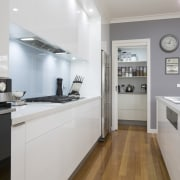 Clean-lined white kitchen with pantry, grey walls and cabinetry, countertop, cuisine classique, interior design, kitchen, property, real estate, room, gray