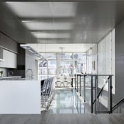 Natural light travels through the metal screen from architecture, ceiling, daylighting, floor, interior design, kitchen, loft, real estate, white, gray, black