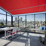 Glass screens enclose a sheltered terrace at the real estate, roof, window