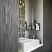 An alcove for a bathroom sink maximizes space bathroom, floor, flooring, interior design, product design, tile, wall, gray, black
