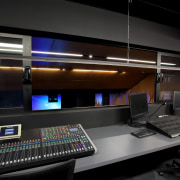Automation Associates configured this Auditorium mixing desk and studio, technology, black