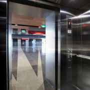 The Otis Gen2 Premier2 elevators on the MIT elevator, floor, glass, interior design, black, gray