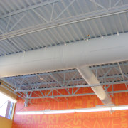 Close-up of the DuctSox Fabric Air Dispersion System, beam, ceiling, daylighting, roof, steel, structure, gray