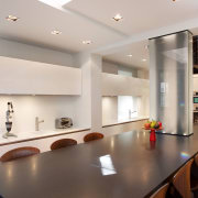 Windows on the rear wall of this kitchen ceiling, countertop, interior design, kitchen, real estate, table, gray