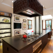 A major remodel has transformed this kitchen, unifying countertop, interior design, kitchen, room, gray