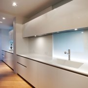 White gloss Boffi cabinets appear to float in architecture, cabinetry, ceiling, countertop, daylighting, floor, glass, home, interior design, kitchen, light fixture, lighting, real estate, room, under cabinet lighting, wall, gray