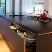 Glass-fronted doors and drawers on the island feature cabinetry, countertop, interior design, kitchen, brown