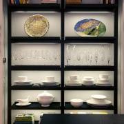 An aluminum and Melamine Boffi display unit displays bookcase, display case, furniture, shelf, shelving, gray, black