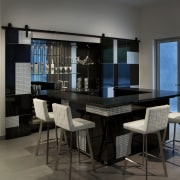 The doors and the front of the island dining room, furniture, interior design, room, table, black, gray