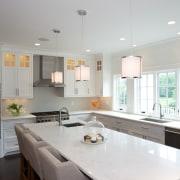 Corner detailing makes the island seem more of ceiling, countertop, daylighting, home, interior design, kitchen, light fixture, lighting, room, table, gray, white