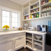 This large pantry occupies the space formerly taken cabinetry, countertop, home, home appliance, interior design, kitchen, refrigerator, room, shelf, shelving, gray