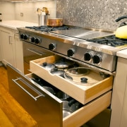 The new kitchen includes a wealth of storage countertop, floor, flooring, interior design, kitchen, kitchen appliance, kitchen stove, room, brown, orange