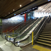 Otis supplied and installed two escalators, for the escalator, metro station, metropolitan area, public transport, train station, brown, black
