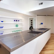 Its sleek, simple and all white  this countertop, interior design, kitchen, real estate, room, gray, white