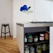 Breakfast items are stored at one end of chest of drawers, furniture, product, product design, shelf, shelving, table, gray