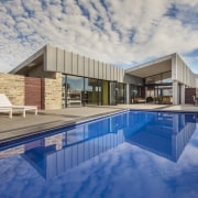 The main living wing of this rural home apartment, architecture, estate, home, house, leisure centre, property, real estate, reflection, sky, swimming pool, villa, water, gray, blue