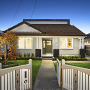 Built in 1928, this California bungalow retains its cottage, estate, facade, home, house, picket fence, property, real estate, residential area, siding, gray