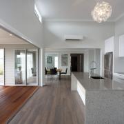 A loggia off the living area of this architecture, daylighting, floor, flooring, hardwood, house, interior design, laminate flooring, living room, real estate, room, window, wood, wood flooring, gray