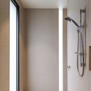 In the master suite, the shower is the bathroom, floor, interior design, plumbing fixture, room, gray