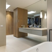 Seen in reflection, the dressing area is in bathroom, floor, interior design, product design, room, sink, gray