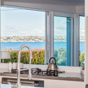 There are sea views from the kitchen and interior design, window, white, gray